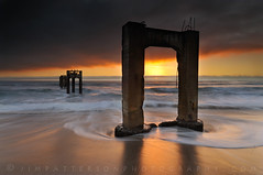 Abandoned Pier - Davenport, California (Jim Patterson Photography) Tags: ocean california county old longexposure sunset sea sky santacruz seascape motion abandoned beach clouds landscape concrete coast pier sand nikon waves pacific decay cement shoreline historic highway1 coastal shore coastline davenport past swell decaying dilapidated rundown pacificcoasthighway d300 landscapephotography nikkor1224mm oceanscape oceanshore platinumphoto nikond300 beneathblueseas beneathblueseascom jimpattersonphotography goldendiamondblog jimpattersonphotographycom goldenblog2010 seatosummitworkshops seatosummitworkshopscom