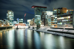 Medienhafen im Winter (Jrg Dickmann) Tags: city schnee winter snow cold reflection topf25 water architecture night buildings germany geotagged deutschland lights harbor topf50 harbour frosty basin nrw canon5d dusseldorf hafen dsseldorf rhine rhein duesseldorf flossies medienhafen winterlich canon1740 mediaharbour hafenbecken winterly mediaharbor colorium jrgdickmann geo:lat=512157 geo:lon=6753576