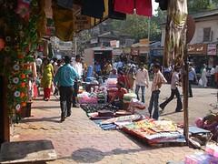 (dinendra.haria) Tags: poverty sleeping sunset india beach buses shopping cafe bath taxis policecar shops mumbai washing poorpeople terrorattacks streetstalls 2611 leopoldcafe 26nov2008