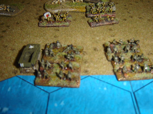 Marines land and hit defending Japanese hard
