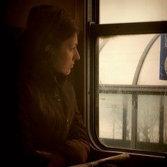 Winter Train (Osvaldo_Zoom) Tags: travel winter portrait woman cold window rain train bravo thoughts commuter 500x500 winner500