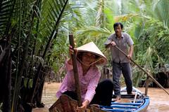 Cruising through the jungle (Martin Bundgaard) Tags: people woman 20d water canon river boat vietnam jungle mekong ef50mm18