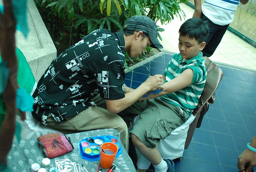 Face Painting Booth. Matthew having his arm painted.