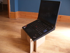 thinkpad on cardboard stand