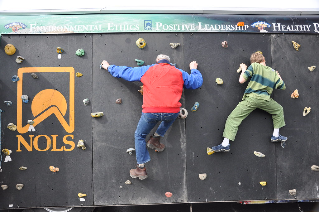 NOLS grad and son climb the wall
