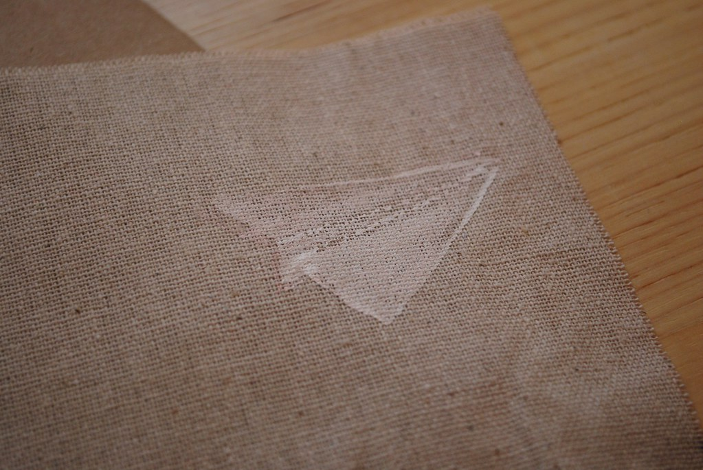paper airplane on fabric