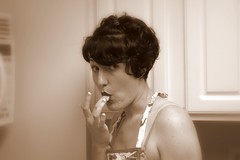 Tastes Good (wbpartridge) Tags: portrait people cooking kitchen girl sepia mashedpotatoes apron wife housewife xsi snakebites 50shousewife