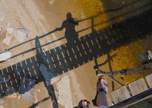 shadow dancing (anniedaisybaby) Tags: light sun lake feet tourism beach pier sand shadows lakedistrict cottagecountry manitoba shore recreation interlake lakewinnipeg poplarpier