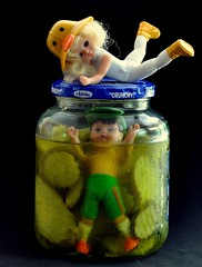 Little Susie Desperately Tries to Unscrew the Lid on the Pickle Jar Her Brother Joey is Trapped In (ricko) Tags: food toys trapped saveme4 deleteme10 joey actionfigures susie pickles crunchy vlasic picklejar