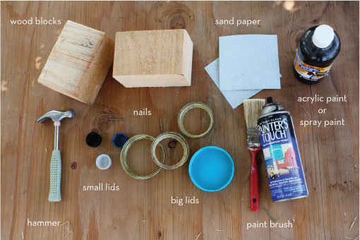 Craft supplies: wood blocks, sand paper, hammer, lids, paint brush, spray and acrylic paint, sand paper