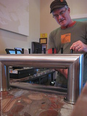 One of the Eagle Rock Brewery brewmasters pours a pint of his finest.
