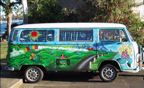 VW bus painted with The Simpsons, Bart and Lisa and Homer and Marge and Maggie and Otto Mann and others from the show
