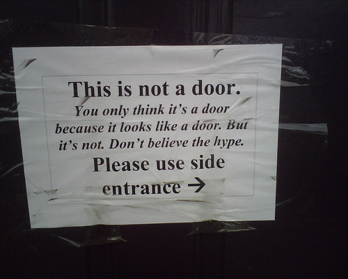 This is not a door. You only think it's a door because it looks like a door. But it's not. Don't believe the hype. Please use side entrance.