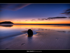 Take only photographs and leave only footprints ([ Kane ]) Tags: sun beach water rock sunrise sand footprints nz kane hdr gisborne gledhill makorori kanegledhill vosplusbellesphotos artinoneshot humanhabits kanegledhillphotography