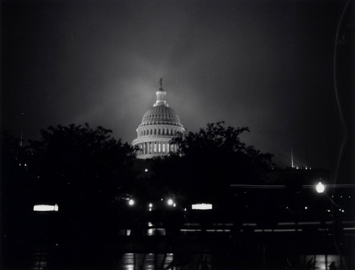 Capitol dome at night, in the rain
