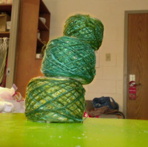 Handspun bombyx silk singles yarn in green, blue, and brown