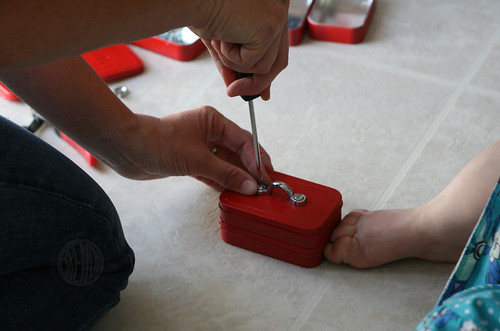screwing handle onto mini toolbox