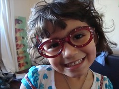 reading glasses (kathyelizabeth) Tags: red girl stars glasses child sweet cuteness spectacles