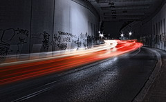 rush rush:  176/365 (helen sotiriadis) Tags: longexposure light red bw white black monochrome car canon graffiti published traffic trails tunnel athens 365 canonefs1022mmf3545usm ndfilter pefki marousi  canoneos40d   toomanytribbles