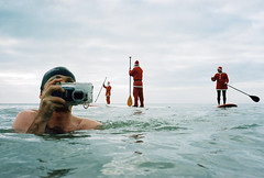 happy christmas clive andrews! (lomokev) Tags: santa christmas sea portrait people man cold male beach water swimming swim fun brighton santas kodak kodakportra400vc longboard shock fatherchristmas clive p
