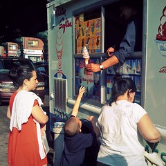 Reaching For Nirvana (antonkawasaki) Tags: newyork streetphotography squareformat icecreamtruck mistersoftee iphone astoriaqueens womaninred 500x500 rainbowsprinkles softserveicecreamcone antonkawasaki reachingfornirvana boyjumpingupanddown reachinghandintotheair mantorturingboy mothertakinghersweettimepaying afterqueensgaypride mobilephotogroup