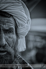 """Reality can destroy the dream; why shouldn't the dream destroy reality?"" (Muhammad Fahad Raza) Tags: old man pakistani pakistan baluchi baluchistan baluchioldman pakistanioldman oldmanfrombaluchistan oldfolksingerfrombaluchistan folksingerfrombaluchistan baluchifolksinger baansuri oldmanwithbaansuri islamabad lokvirsa baluchistanfolkfestival ppa 1stmay2010 labour day folkmusicofpakistan folkmusicofbaluchistan labourday laborday fluke oldmanplayingafluke baluchiplayingfluke headshot portrait culture festivity pakistaniculture folkfestivity goldenbeard beard golden mehndi hena intenseeyes intensity flute desiflute desimusic music alookintothesoul muhammadfahadraza cyanotype cyanotypeprocessing bright eyes brighteyesshiny eyessparklingeyes baloch balochman balochi folk singer balochifolksinger singerfrombalochistan manfrombalochistan balochistansfolksinger street streetportrait streetphotography"