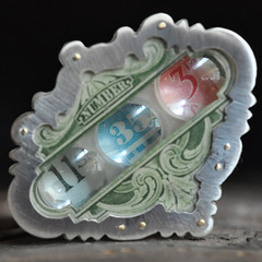 Stamp Collection (Pink Crow Studio) Tags: art studio lens handmade jewelry layers brass postage postagestamp fabricated metalsmith sterlingsilver upcycled stockcertificate carrieboucher