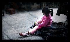 VIETNAM - The Pink Girl and her Shoe ! :o) (Sebastien LABAN) Tags: street pink vacation sun holiday color cute girl face fog hair fun thailand lights kid shoes little cutie vietnam phuket hanoi 2008 along halong buidling pucket diamondclassphotographer flickrdiamond