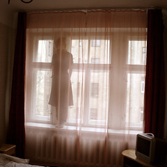 (mioke) Tags: light girl rose hotel bed curtain hiding moki