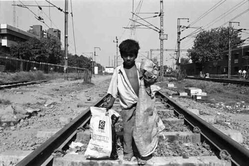 Rag picker on railway tracks