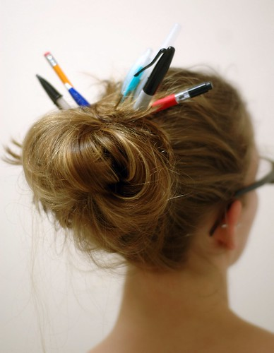 back of hair in a bun with pencils sticking out of it