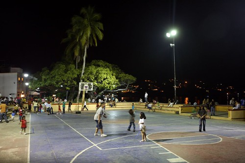 The town basketball court in the evening.