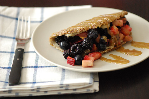 Raw Crepes stuffed with Vanilla Lemon Pine Nut Cream, spiced fruit salad, and date syrup