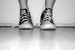 coming undone. (laurenelizabeth;) Tags: white black feet me wall grey sad floor legs converse dust chucks shoelaces
