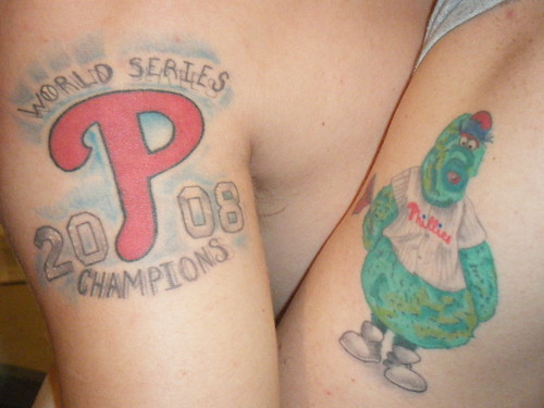 Style permanent tattoo on his arm, tattoos colorful word champion