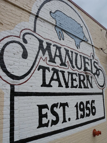 The cavernous Manuel's Tavern features 27 beers on tap and dozens of local and import beers.  Hamburgers with fries are just $5.95.