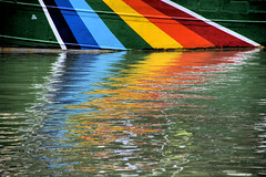 The rainbow of the Warrior (basajauntxo) Tags: reflection arcoiris rainbow barco colours greenpeace colores bilbao reflejo warrior museo bizkaia ria velero maritimo nervion nerbioi basajauntxo coth5