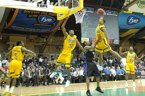 Jamario Moon dunks in a January 2006 Albany Patroons game.  Photo copyright Chuck Miller.