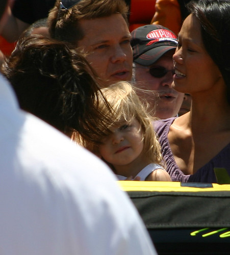 Ella with her mom (head down so all you can see is her hair) stand by the 24 dupont Chevy of Jeff Gordon. Photo Credit: ME