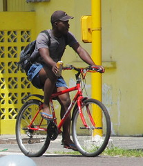What to do? (Legin_2009) Tags: road street man black male men guy bike bicycle shirt outside outdoors ride drink african sandals guys can riding cap backpack males caribbean shorts soda stoplight poloshirt polo teeshirt slippers mnner hombres mec knapsack  mecs  gason haversack   flopflops  hommes homens