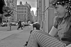 Fishnette Vignette (Alyssa L. Miller) Tags: street nyc newyorkcity sunset blackandwhite bw white black girl beautiful mystery intense eyes alley nikon hand skyscrapers smoke fear innocent dramatic stranger eerie sidewalk portraiture mysterious posterized cigarrette shortfilm naturalillumination d5000 offerslanted