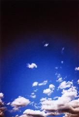 And sometimes I just lose it staring at the sky (ale2000) Tags: blue sky white black clouds lost lca xpro nuvole blu crossprocess fluffy ct cielo photowalk stare agfa staring vignetting bianco nero nubi precisa agfactprecisa gettinglost vignettatura aledigangicom