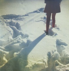This Day Will Never Happen Again (Kate Pulley) Tags: winter red snow film girl polaroid sx70 sister coat tights 600 footsteps balloo borderless bluecamera