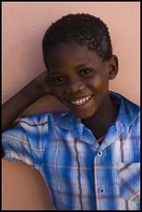 Beautiful Son, Kalahari, Namibia (Izla Kaya Bardavid) Tags: africa boy portrait people smile kids children happy photo kid nikon san child namibia kalahari afrique bushmen colourcolor kalaharidesert sanpeople iloveyoursmile bushmanland
