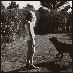 with tilly (HAikman) Tags: summer portrait dog sun girl youth garden hair polaroid spring pretty photographer child cousins traditional ellie blad hasselblad blonde expressive emotive tilly haikman