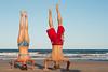 Handstands on Mission Beach (Christian Haugen) Tags: beach jumping bestof action fast australia midair missionbeach shutterspeed roadtrip2009