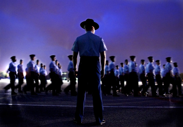 A group of 324th Training Squadron basic trainees perform formation and