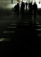 As Usuall (iM@n) Tags: road street city travel light people urban woman man building netherlands dark walking lowlight europe path walk low nederland thenetherlands silhouettes pedestrian eindhoven together usuall ppl p iranian passage society  brabant weary