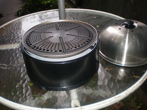 The grills lid is supposed to be used mainly for roasting and baking applications but I also needed it to keep the rain off our food.