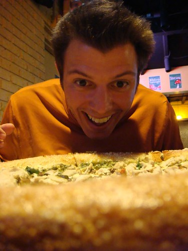 Bryan behind the delicious Mellow Mushroom pizza. Wilmington, NC.